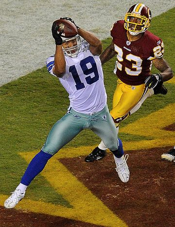 Dallas Cowboys wide receiver Miles Austin pulls in a touchdown pass as Washington Redskins cornerback DeAngelo Hall watches during the second half of an NFL football game in Landover, Md., on Sunday, Sept. 12, 2010.  (AP Photo/Nick Wass)