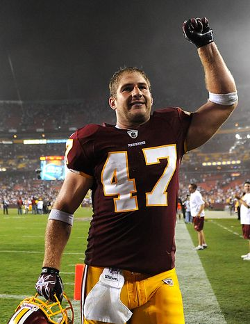 Washington Redskins tight end Chris Cooley celebrates as he leaves the field after the Redskins defeated the Dallas Cowboys 13-7 at FedEx Field in Landover, Maryland on September 12, 2010.  UPI/Kevin Dietsch