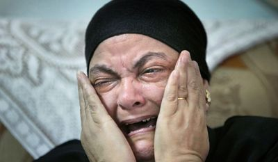 Ibrahim's mother, Mariam Labib, talks in July of her daughter's death. Ibrahim had complained of spousal abuse and had wanted a divorce, but her parents and Coptic belief banned it. (Associated Press)