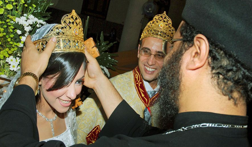 "Irini Ibrahim (left) and Rizk Kands are married on Oct. 14, 2008, by Coptic priest Bejemeni Shawki in Alexandria, Egypt. In April, Ibrahim was found murdered in a hotel room she and her husband had reserved after ""reconciliation sessions."" (Associated Press)"