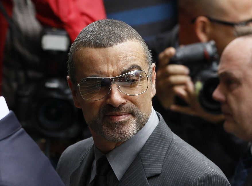 British singer George Michael arrives for sentencing at Highbury Corner Magistrates' Court in London on Tuesday, Sept. 14, 2010. The star pleaded guilty last month to driving under the influence and possession of cannabis following an incident on July 4 when his Range Rover crashed into a photo shop in north London. (AP Photo/Kirsty Wigglesworth)