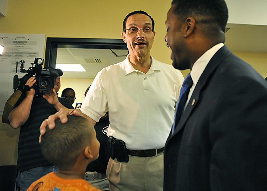 D.C. Mayoral candidate Vincent Gray (C) talks to Kwame Brown, candidate for Chairman of the Council, and his son Kwame Jr. prior to voting in the D.C. Mayoral Primary Election at the Washington Senior Wellness Center in Washington on September 14, 2010. Gray is in a heated Mayoral race with incumbent Adrian Fenty.  UPI/Kevin Dietsch