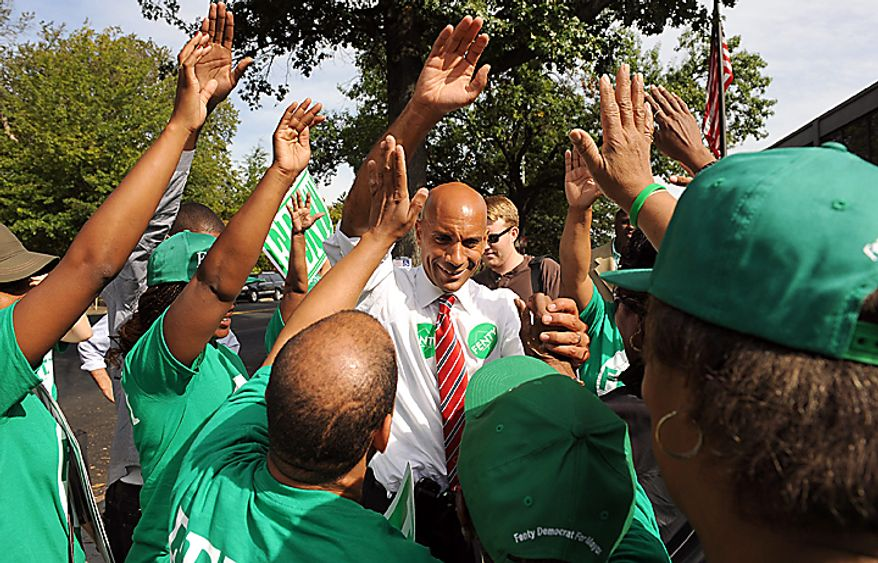 Washington D.C. Mayor Adrian Fenty talks to supporters outside of a polling place during primary voting in Washington on September 14, 2010. Fenty is in a heated race with challenger Vincent Gray.   UPI/Roger L. Wollenberg