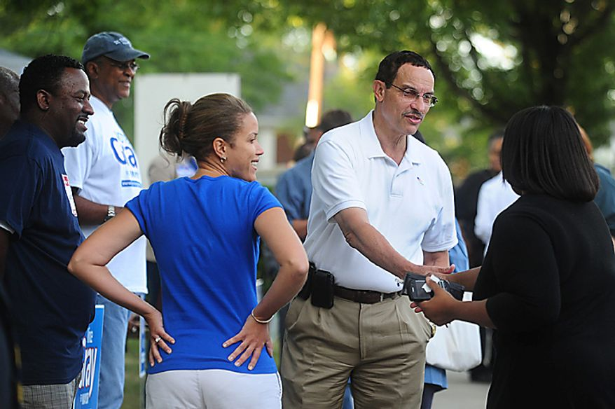 D.C. Mayoral candidate Vincent Gray greets voters outside the St. Timothy's Church voting location on D.C. Mayoral Primary Election day in Washington on September 14, 2010. Gray is in a heated Mayoral race with incumbent Adrian Fenty.  UPI/Kevin Dietsch