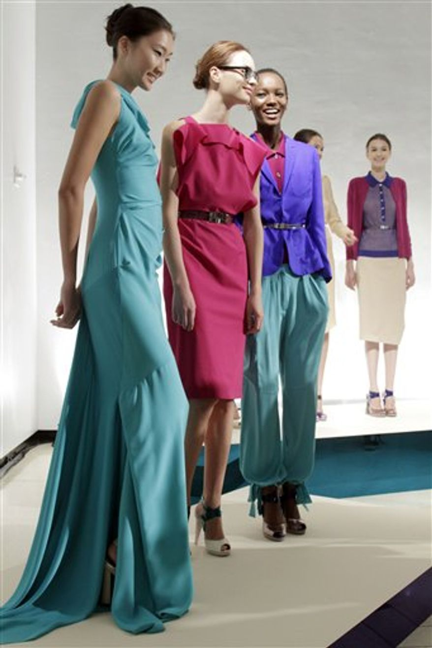 The spring 2011 collection of designer Rachel Roy is modeled during Fashion Week in New York, Tuesday, Sept. 14, 2010. (AP Photo/Richard Drew)