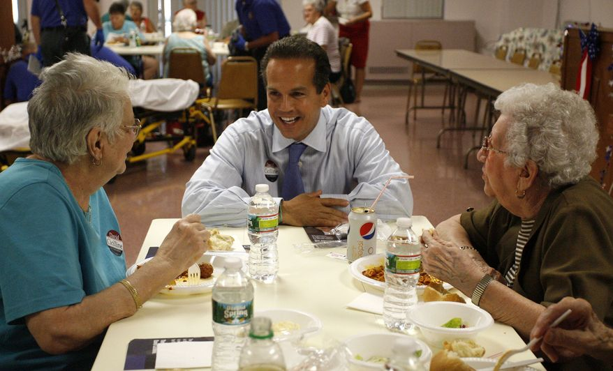 Providence, R.I., Mayor David N. Cicilline, who is running to succeed Rep. Patrick J. Kennedy, talks with Louise Pasacane (left) and Violet Champagne during a pasta dinner at an elder-care facility in Woonsocket, R.I., on Sept. 2, 2010. (AP Photo/Stew Milne)