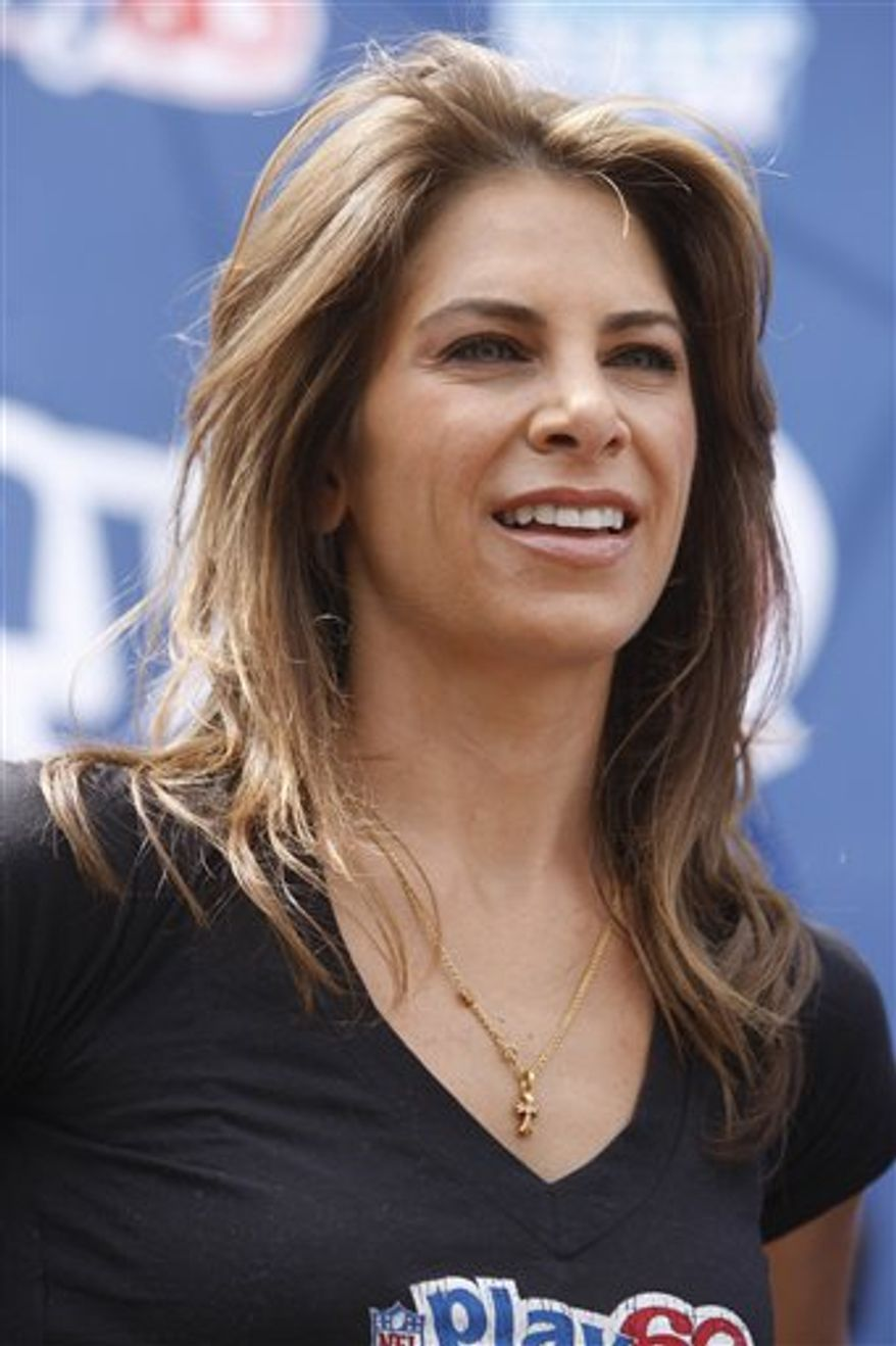 """FILE - This April 21, 2010 file photo shows Jillian Michaels at a youth football clinic in New York. GoDaddy.com is adding a second spokeswoman as it closes in on $1 billion in annual sales this year: Jillian Michaels, the fitness guru that Go Daddy founder and CEO Bob Parsons calls """"smokin' hot.""""(AP Photo/Seth Wenig, File)"""