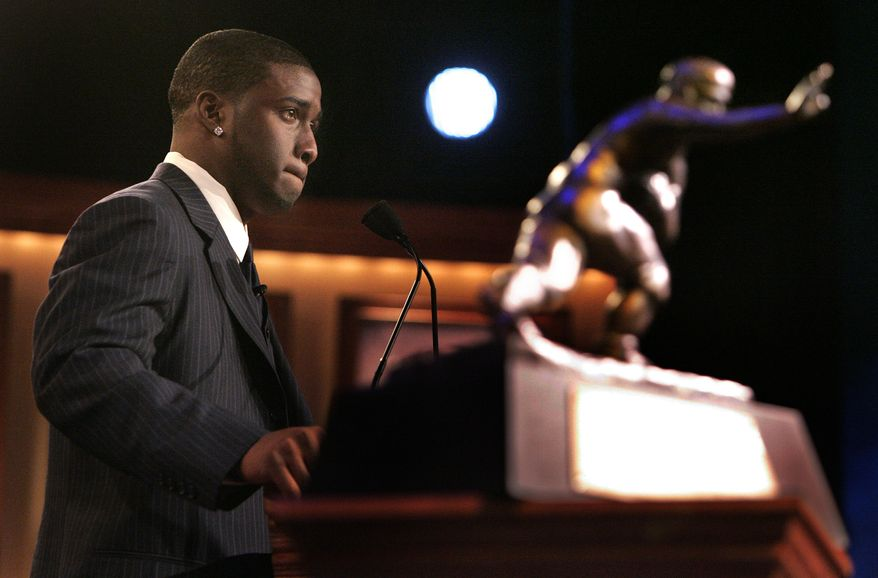 ** FILE ** University of Southern California tailback Reggie Bush pauses while giving his acceptance speech as the winner of the Heisman Trophy in New York in December 2005.