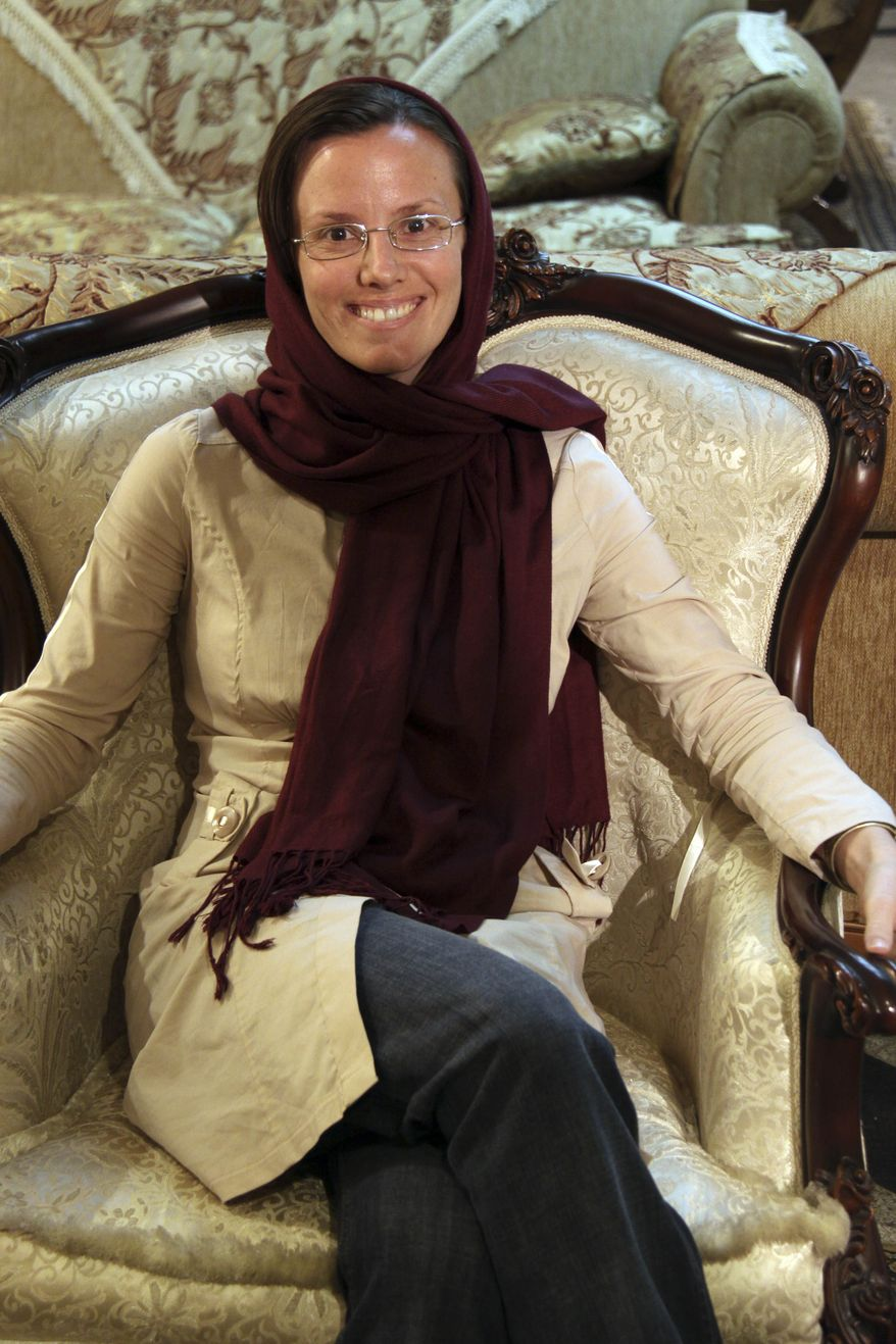 Sarah Shourd, 32, of the U.S., poses for a photograph at Mehrabad airport prior to leaving Tehran, Iran, Tuesday, Sept. 14, 2010. (AP Photo/Press TV)