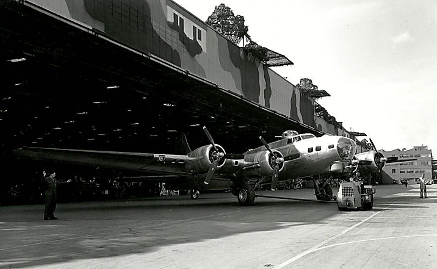 """In this March 31, 1944 photo from the Boeing Co. archive, a B-17G Flying Fortress airplane is shown at Boeing's historic """"Plant 2"""" in Seattle, with camouflage used to hide the building from aerial attacks during World War II visible on the roof. After giving birth to some of the world's most significant aircraft, the outdated facility is scheduled to be torn down in the fall of 2010. (AP Photo/Courtesy Boeing Co.)"""