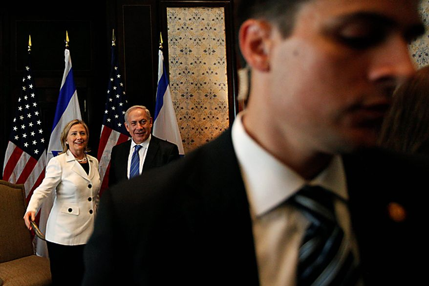 Security officers, right, move media personnel out of the room after a photo opportunity during the meeting of U.S. secretary of state Hillary Rodham Clinton, left, with Israeli prime minister Benjamin Netanyahu, center, at the Red Sea resort of Sharm el-Sheik, Egypt, Tuesday Sept. 14, 2010.   The most immediate dispute between the two sides surrounds the current Sept. 26 deadline on restriction of new construction for Israeli settlers in the West Bank. (AP Photo/Nasser Nasser)
