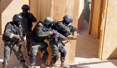 Soldiers from the anti-terrorism force of the Yemeni Defense Ministry are training, with U.S. military assistance, to take on a more diverse, independent and scattered al Qaeda network. (Associated Press)
