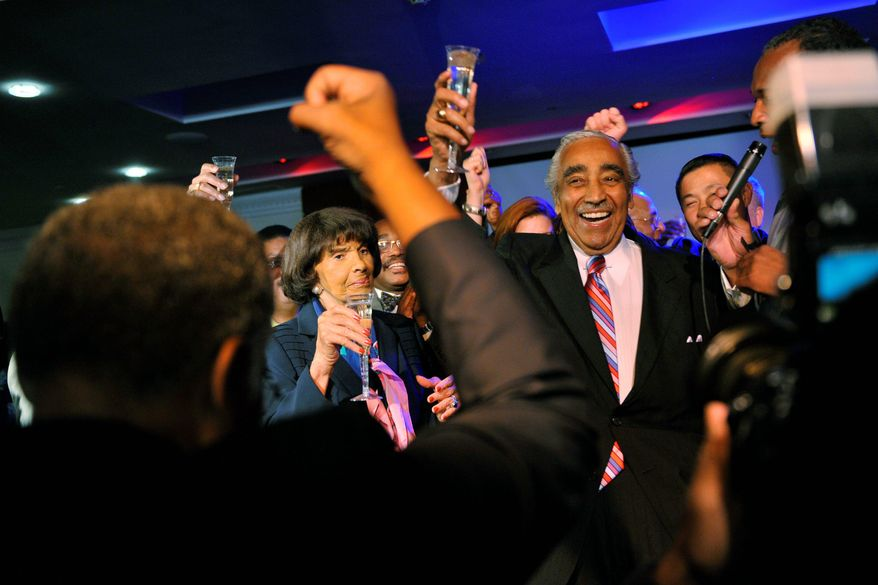 Rep. Charles B. Rangel, New York Democrat, his wife, Alma, and supporters toast his victory in the congressional primary Tuesday in New York. Mr. Rangel, a 20-term congressman facing 13 ethics charges, was challenged by four other Democrats, most notably Assemblyman Adam Clayton Powell IV.