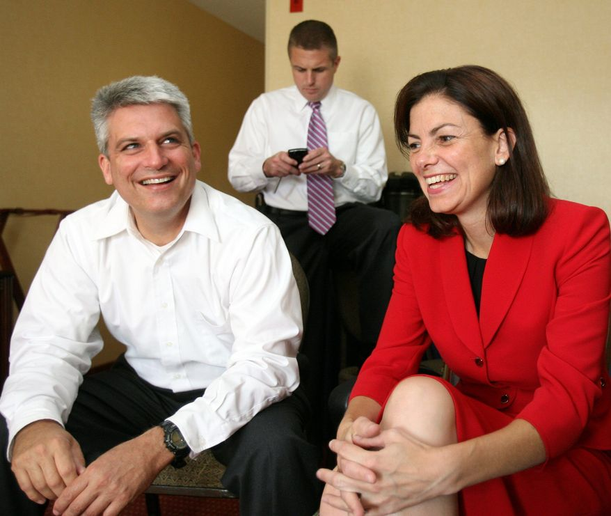 Kelly Ayotte, celebrates with her husband, Joe Daley, after learning she won the Republican nomination for U.S. Senate in Concord, N.H. The former state attorney general defeated tea-party-backed conservative Ovide Lamontagne in the GOP primary on Tuesday.