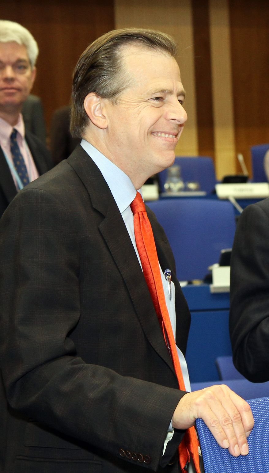 Glyn Davies, U.S. ambassador to the International Atomic Energy Agency, waits for the start of the IAEA's board of governors meeting at the International Center in Vienna, Austria, on Wednesday, Sept. 15, 2010. (AP Photo/Ronald Zak)