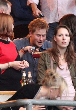 Britain's Prince Harry, center, attends the 'Help For Heroes' Concert at Twickenham Stadium, London Sunday Sept. 12, 2010. Some 60,000 concert goers will attend the concert in aid of the 'Help For Heroes' charity which supports members of Britain's armed forces.    (AP Photo/Yui Mok/PA Wire)