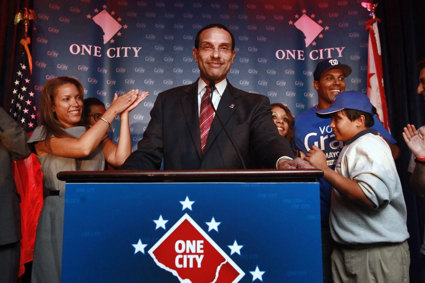 Surrounded by his family including his daughter Jonice Gray Tucker, left, District of Columbia mayoral candidate and Council Chairman Vincent Gray, center, announces his win in the primary against Mayor Adrian Fenty at Gray's primary party in Washington, on Wednesday Sept. 15, 2010. (AP Photo/Jacquelyn Martin)
