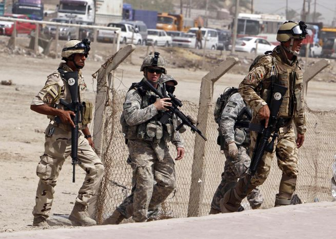 **FILE** U.S. Army soldiers and Iraqi security forces secure the scene of a roadside bomb attack in Basra, Ir