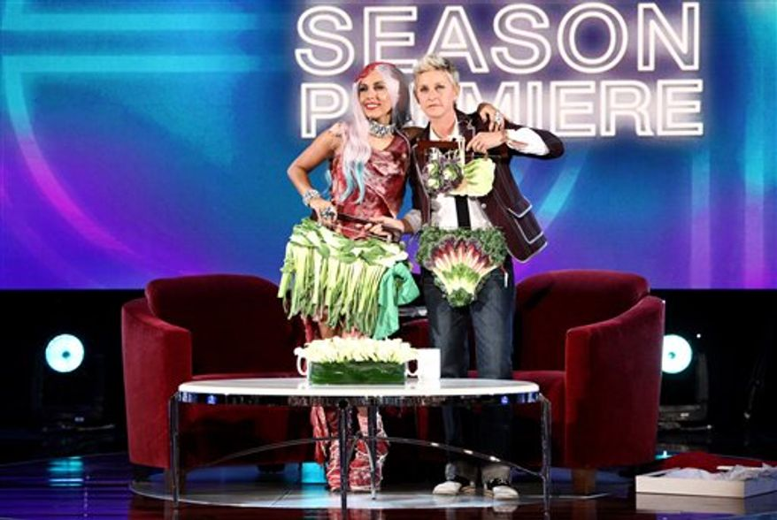 """In this photo released by Warner Bros. on Monday, Sept. 13, 2010, talk show host Ellen DeGeneres, right, gives Lady Gaga """"veggie bikini"""" inspired by her """"meat bikini"""" on the Japanese Vogue Cover during the taping of Season 8 Premiere of """"The Ellen DeGeneres Show"""" from Club Nokia on-site at the MTV Video Music Awards, in Los Angeles. This episode airs Monday, Sept. 13. (AP Photo/Warner Bros., Michael Rozman) NO SALES."""