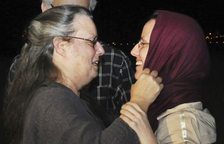 Sarah Shourd (right) embraces her mother, Nora Shourd, upon Sarah Shourd's arrival at the royal airport in Muscat, Oman, on Tuesday, Sept. 14, 2010, after leaving Tehran.  (AP Photo/Sultan al-Hasani)
