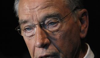 "Sen. Charles Grassley, Iowa Republican, speaks to reporters after a joint interview with Democratic challenger Roxanne Conlin on Iowa Public Television's ""Iowa Press"" on Sept. 10, 2010, in Johnston, Iowa. (Associated Press)"