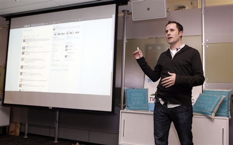 Twitter co-founder Biz Stone, left, talks about changes to the social network at Twitter headquarters in San Francisco, Tuesday, Sept. 14, 2010. Twitter is turning its short-messaging website into a multimedia showcase by adding a new pane that will make it easier for its 160 million users to peruse photos and video. (AP Photo/Marcio Jose Sanchez)