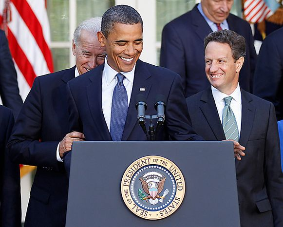 Vice President Joe Biden, left, playfully hides behind President Barack Obama, center, in the Rose Garden of the White House in Washington, DC, as Treasury Secretary Timothy Geithner looks on at right. Obama made a statement on the Senate cloture vote to allow a final vote on a bill setting aside a 30 billion dollar fund to help small U.S. businesses tide over a credit crunch, Wednesday, Sept. 15, 2010.  (AP Photo/Pablo Martinez Monsivais)