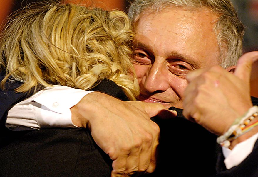 Carl Paladino receives a hug on stage after winning the New York State Republican Gubernatorial primary in Buffalo, N.Y., Tuesday, Sept. 14, 2010. (AP Photo/Don Heupel)