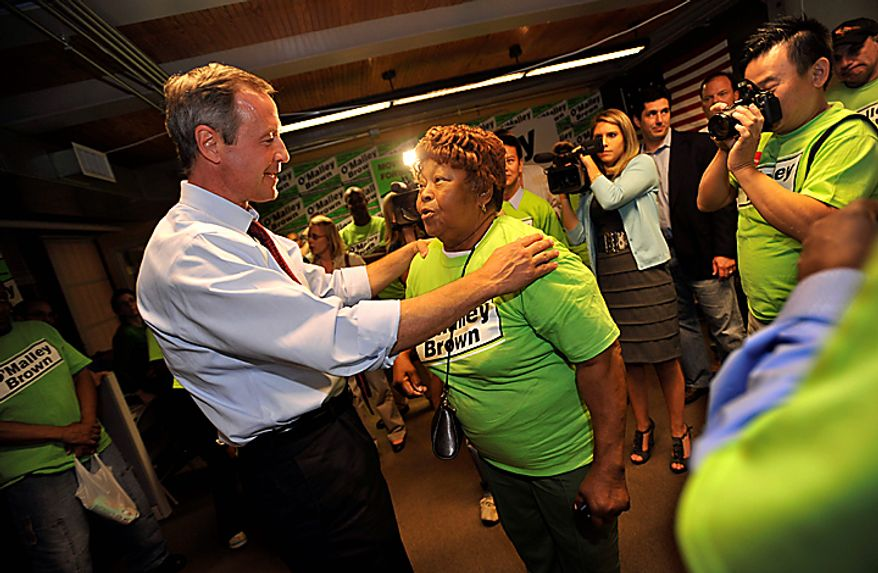 Maryland Gov. Martin O'Malley greets volunteer Carolyn D. Robinson after winning the Democratic primary for governor at his headquarters Tuesday, Sept. 14, 2010 in Baltimore.(AP Photo/Gail Burton)