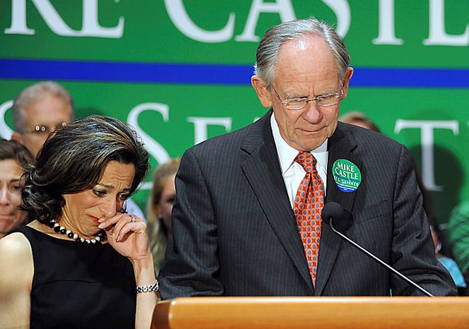 """Rep. Michael N. Castle, a Republican candidate for Senate from Delaware, here with his wife, Jane, addresses supporters after his defeat in the primary election on Tuesday, Sept. 14, 2010, in Wilmington, Del. Mr. Castle lost to """"tea-party"""" favorite Christine O'Donnell. (AP Photo/Steve Ruark)"""
