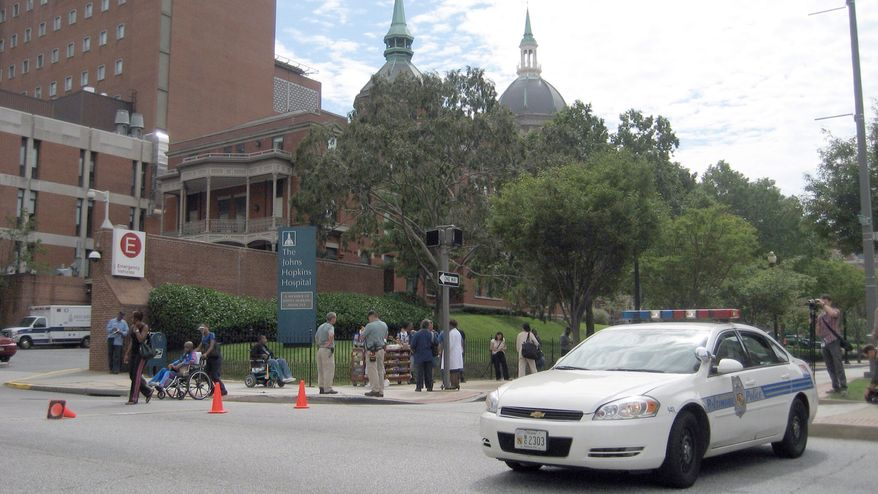 A police vehicle arrives at Johns Hopkins Hospital in Baltimore, where a shooting was reported on Thursday, Sept. 16, 2010. Police spokesman Anthony Guglielmi said some parts of the hospital are being evacuated, but not the entire massive complex. (AP/Alex Dominguez)