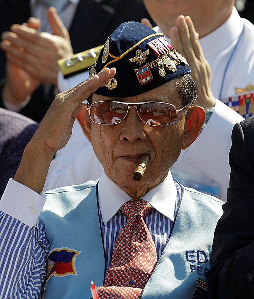 Former Philippine President Fidel Ramos, also Korean War veteran, salutes during the 60th Incheon Landing Operations Commemoration Ceremony, Wednesday, Sept. 15, 2010 at sea near Incheon, the coastal city where United Nations Forces led by U.S. General Douglas MacArthur landed in September, 1950 just months after North Korea invaded the South. (AP Photo/ Lee Jin-man)