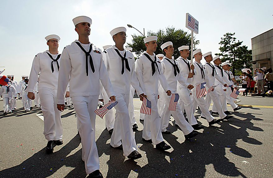 U.S. sailors march on a street to celebrate the 60th anniversary of the Incheon Landing Operation, Wednesday, Sept. 15, 2010, near Incheon, the coastal city where United Nations Forces led by U.S. Gen. Douglas MacArthur landed on Sept. 15, 1950, just months after North Korea invaded the South. (AP Photo/Lee Jin-man)