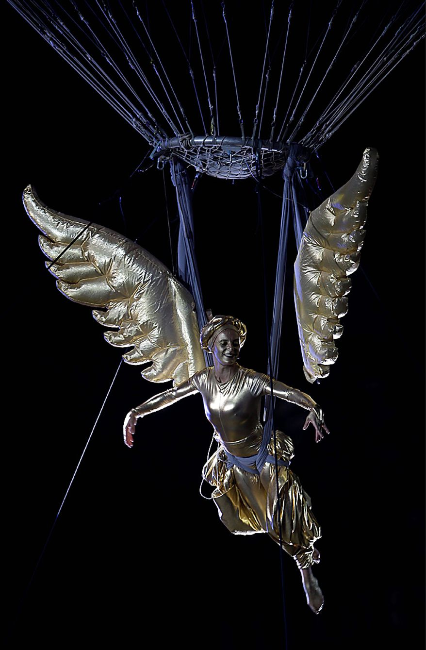 A woman portraying the Angel of Independence hangs from a hot air balloon during bicentennial celebrations in Mexico City's main Zocalo plaza, Wednesday Sept. 15, 2010. Mexico celebrates the 200th anniversary of its 1810 independence uprising. (AP Photo/Dario Lopez-Mills)