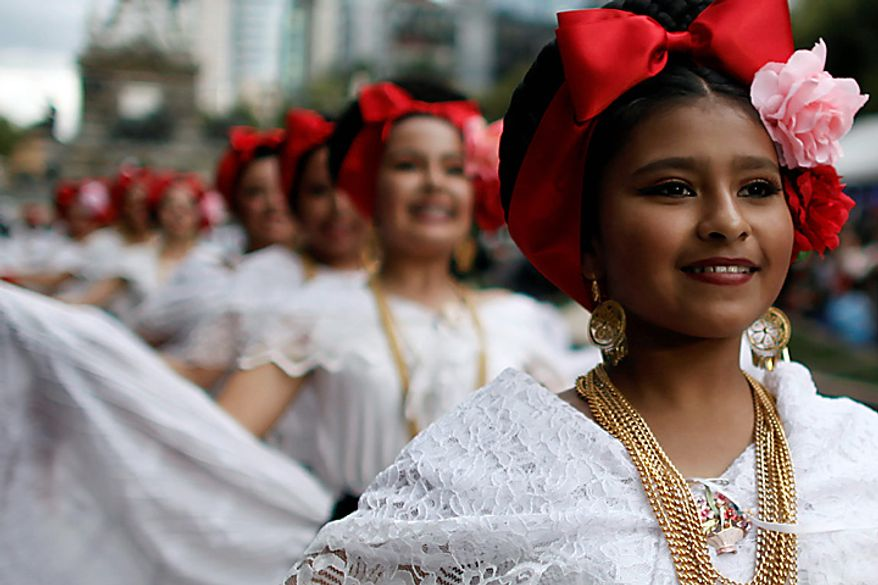 Dancers perform during the bicentennial parade in Mexico City, Wednesday Sept. 15, 2010. Mexico celebrates the 200th anniversary of its 1810 independence uprising. (AP Photo/Miguel Tovar)