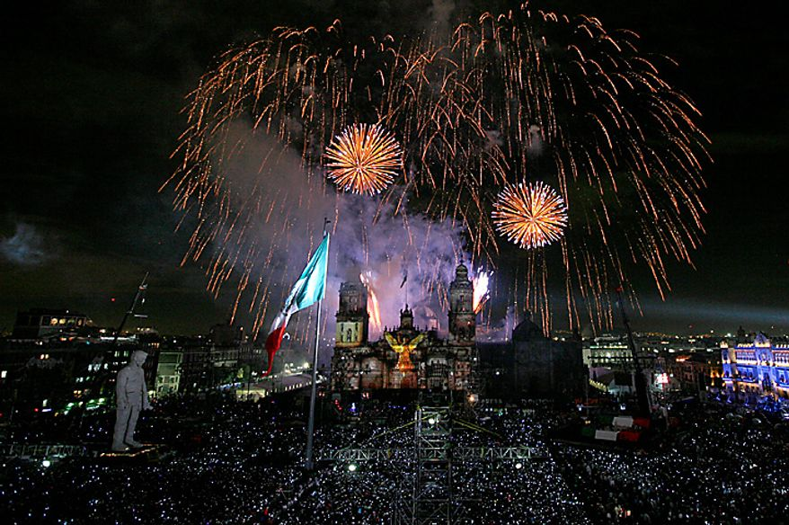 Fireworks explode over the Zocalo plaza during bicentennial celebrations in Mexico City, Wednesday Sept. 15, 2010.  Mexico celebrates the 200th anniversary of its 1810 independence uprising. (AP Photo/Marco Ugarte)