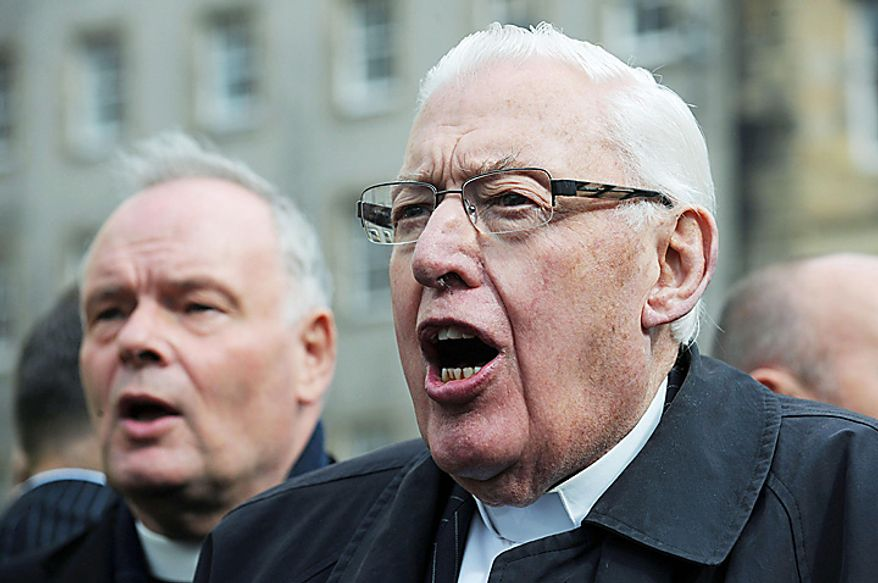 Reverend Ian Paisley, right, prominent Northern Ireland  Protestant politician,  joins a protest in Edinburgh against the visit of Pope Benedict XVI who arrived in the city earlier in the day for a four day visit to Britain Thursday Sept. 16, 2010. (AP Photo/Anna Gowthorpe/PA)