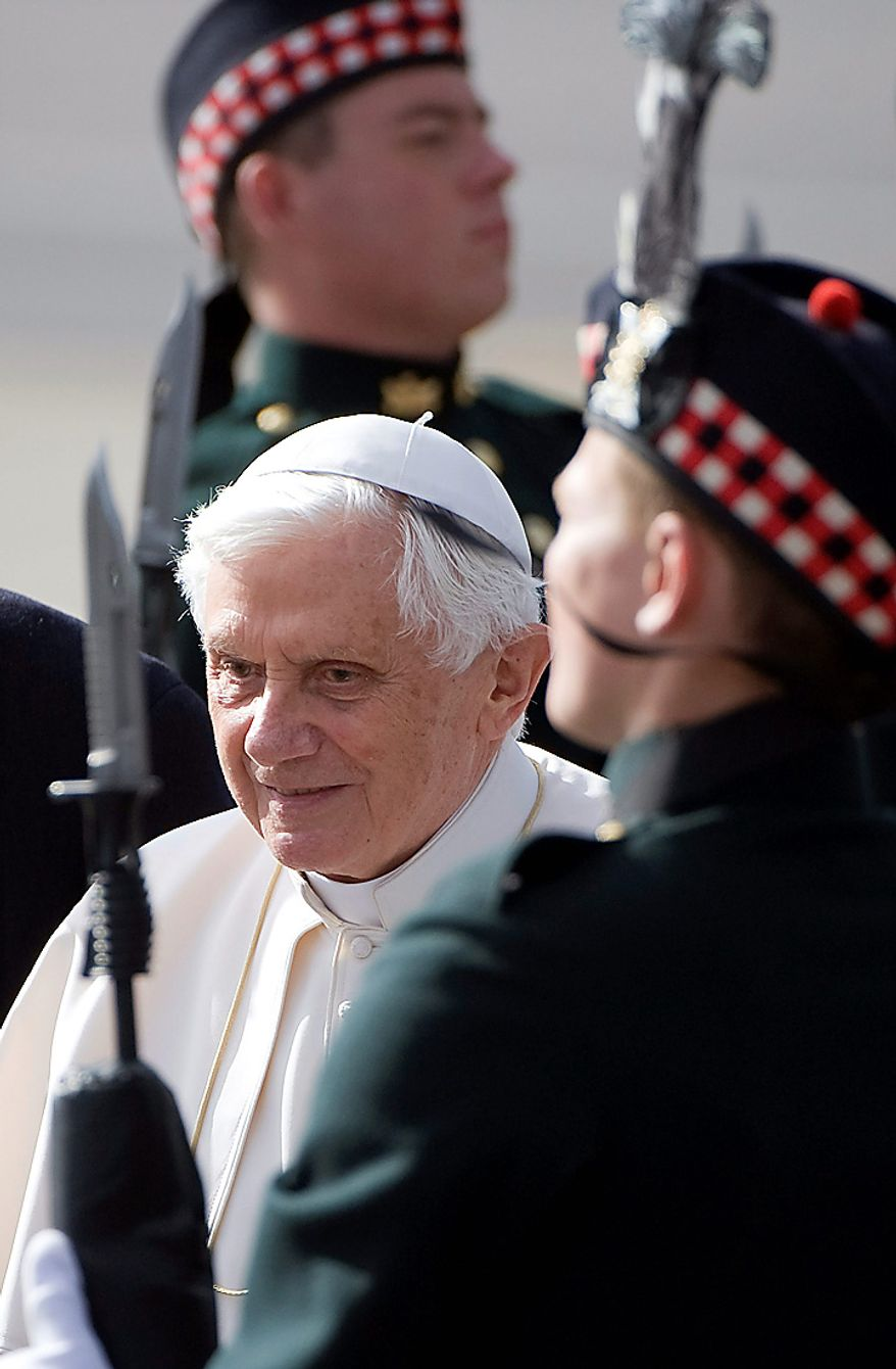 Pope Benedict XVI inspects a guard of honor after his arrival at Edinburgh airport in Scotland, Thursday Sept. 16, 2010. Pope Benedict XVI arrives in the United Kingdom on Thursday for a four-day visit, a controversial yet historic state trip that has been overshadowed by the sex abuse scandals which have shaken confidence in the Roman Catholic Church.   (AP Photo/Derek Blair, Pool)