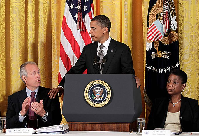 President Barack Obama announces his recommendations to work on free trade agreements and to step up trade promotion at a meeting of his export council, Thursday, Sept. 16, 2010, in the East Room of the White House in Washington. He is flanked by Boeing President Jim McNerney, chair of the President's Export Council, left, and XEROX CEO Ursula Burns,  vice chair of the President's Export Council. Less than two months before congressional elections, and with the economy a top issue for voters, Obama is turning his attention to trade, highlighting his goal of doubling U.S. exports over five years to drive economic growth. (AP Photo/J. Scott Applewhite)