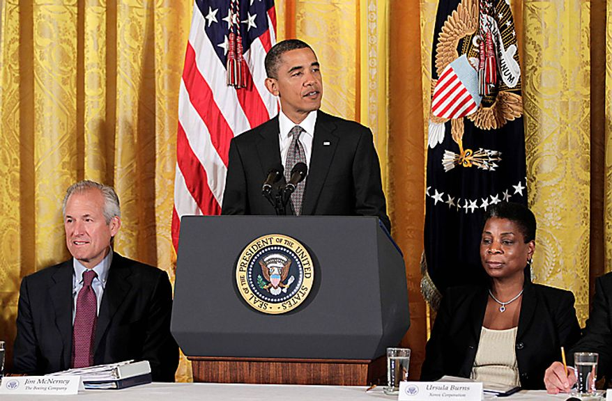 President Barack Obama announces his recommendations to work on free trade agreements and to step up trade promotion at a meeting of his export council, Thursday, Sept. 16, 2010, in the East Room of the White House in Washington. He is flanked by Boeing President Jim McNerney, chair of the President's Export Council, left, and Xerox Corporation CEO Ursula Burns, vice chair of the President's Export Council. (AP Photo/J. Scott Applewhite)