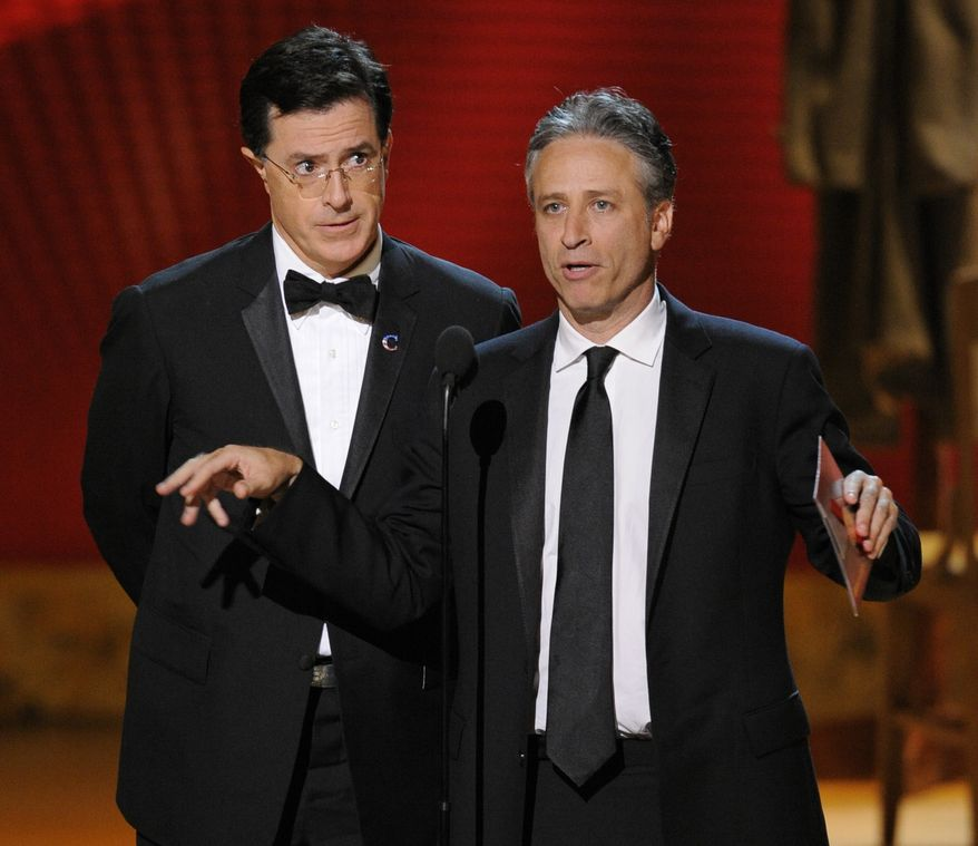 In this Sept. 21, 2008, file photo, Stephen Colbert, left, and Jon Stewart make an award presentation at the 60th Primetime Emmy Awards in Los Angeles. The Comedy Central duo plans to hold two marches on the Washington Mall on Oct. 30. (AP Photo/Mark J. Terrill, file)