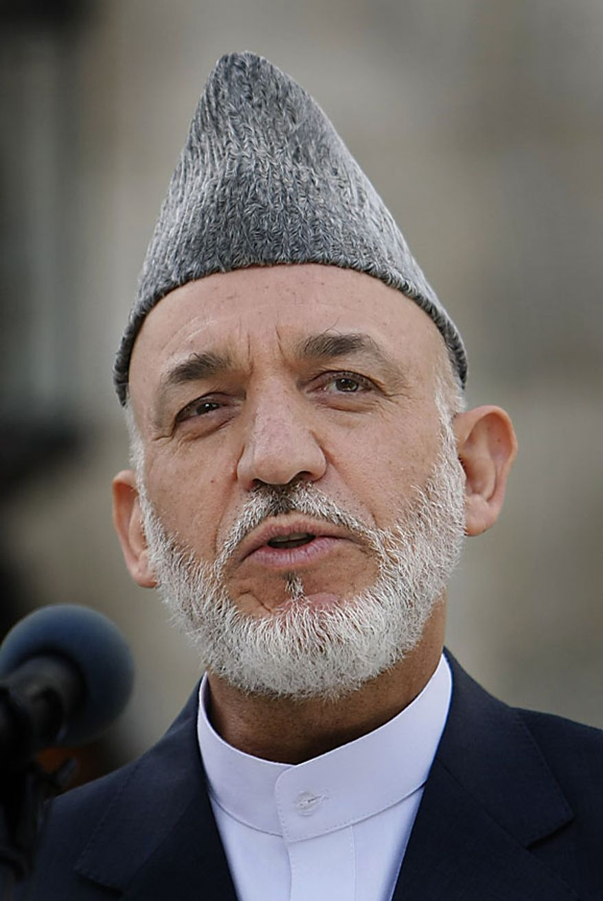 Afghan President Hamid Karzai delivers a speech in Kabul, Afghanistan, Friday, Sept. 17, 2010. Karzai urged Afghans to vote in this weekend's parliamentary election despite threats from the Taliban warning people not to leave their homes. (AP Photo/ Gemunu Amarasinghe)