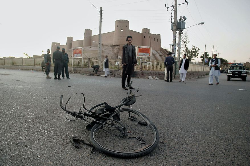 A cycle in which a bomb were concealed is seen after it exploded injuring four people in Herat, Afghanistan, Friday Sept. 17, 2010. Afghan President Hamid Karzai urged citizens to vote in Saturday's parliamentary election despite fears of violence and threats from the Taliban warning people not to leave their homes. (AP Photo/Reza Shirmohammadi)