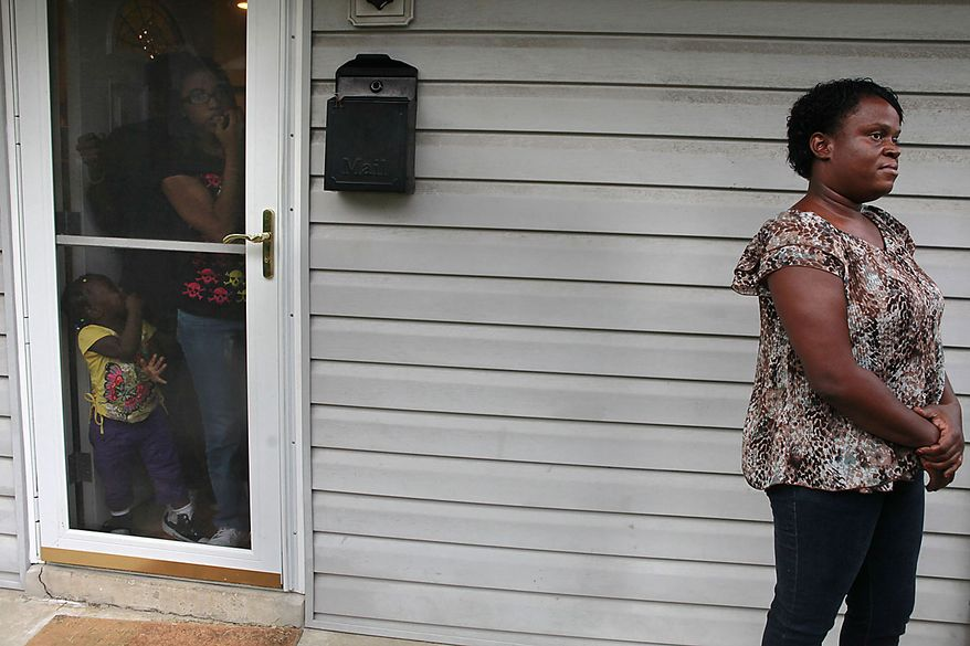 Teresa Green, right, a neighbor of Paul Warren Pardus, is interviewed at her home as her family members watch in Arlington, Va. on Thursday, Sept. 16, 201. Pardus became distraught as he was being briefed on his mother's condition by a surgeon at Johns Hopkins Hospital in Baltimore, pulled a gun and shot the doctor Thursday, then killed his mother and himself in her room at the world-famous medical center, police said. (AP Photo/Jacquelyn Martin)