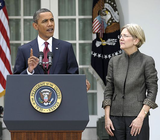 President Barack Obama, accompanied by Elizabeth Warren, announces that Warren will head the Consumer Financial Protection Bureau, Friday, Sept. 17, 2010, during an event in the Rose Garden of the White House in Washington. (AP Photo/Susan Walsh)