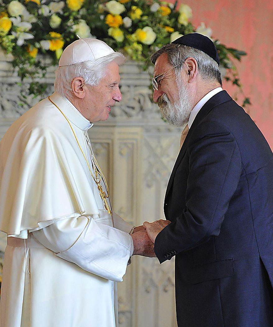 Pope Benedict XVI meets Britain's Chief Rabbi Jonathan Sacks, right, at a meeting of religious leaders at St Mary's University College Chapel at Twickenham in west London, Friday, Sept. 17, 2010. The Pope is on a four-day visit to England and Scotland. (AP Photo/Toby Melville, Pool)