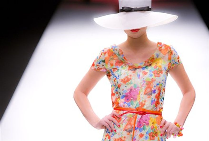 A model wears an outfit by designer Caroline Charles during her show at London Fashion Week, in London, Friday, Sept. 17, 2010. The designers are showing their Spring/Summer 2011 collections. (AP Photo/Joel Ryan)
