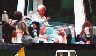 "Pope Benedict XVI arrives by ""Popemobile"" for the Prayer Vigil, as seen on a large screen, at Hyde Park in London Saturday Sept. 18, 2010. (AP Photo / Chris Ison, Pool)"