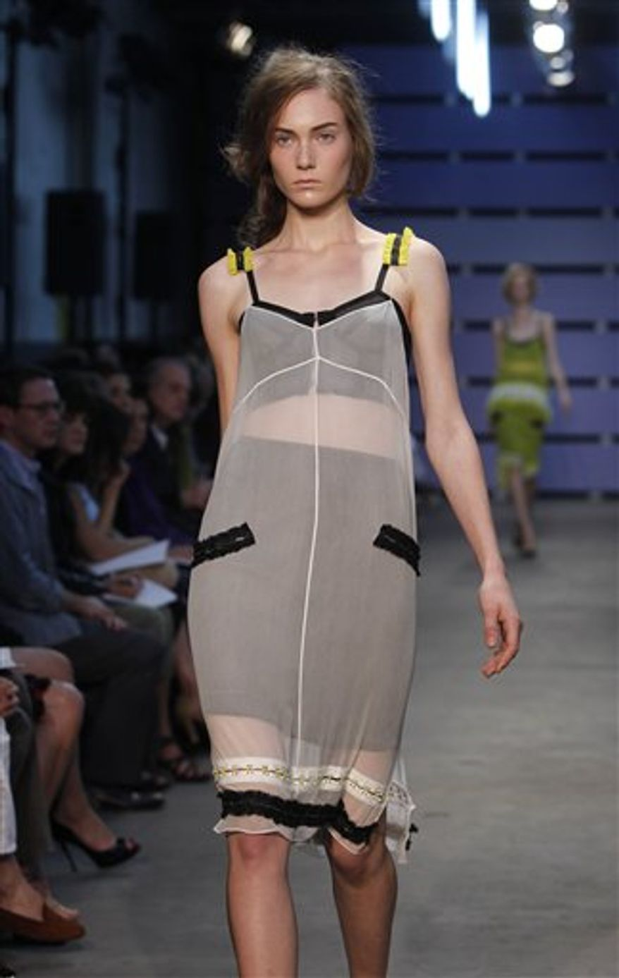 The Proenza Schouler spring 2011 collection is modeled during Fashion Week in New York, Wednesday, Sept. 15, 2010.  (AP Photo/Seth Wenig)