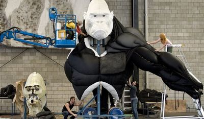 """In this publicity image released by Boneau/Bryan-Brown, workers assemble a King Kong creature in preparation for """"King Kong: Live on Stage,"""" at the Creature Theatre Company workshop in Melbourne. (AP Photo/Boneau/Bryan-Brown, Simon Schluter)"""